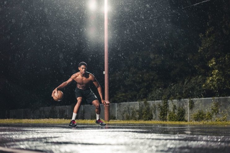 Basketball dribbling in rain