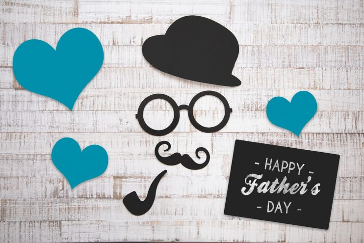 Fathers day gifts card with cut paper on background.