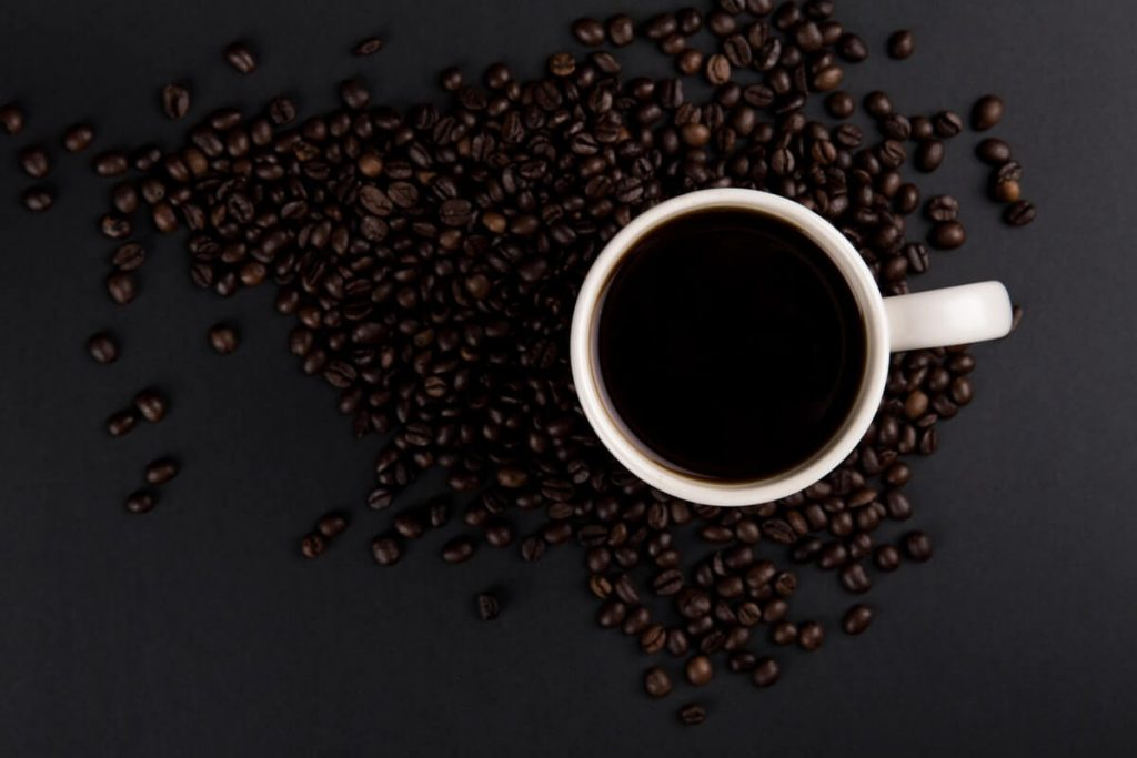 Coffee beans and cup of coffee.